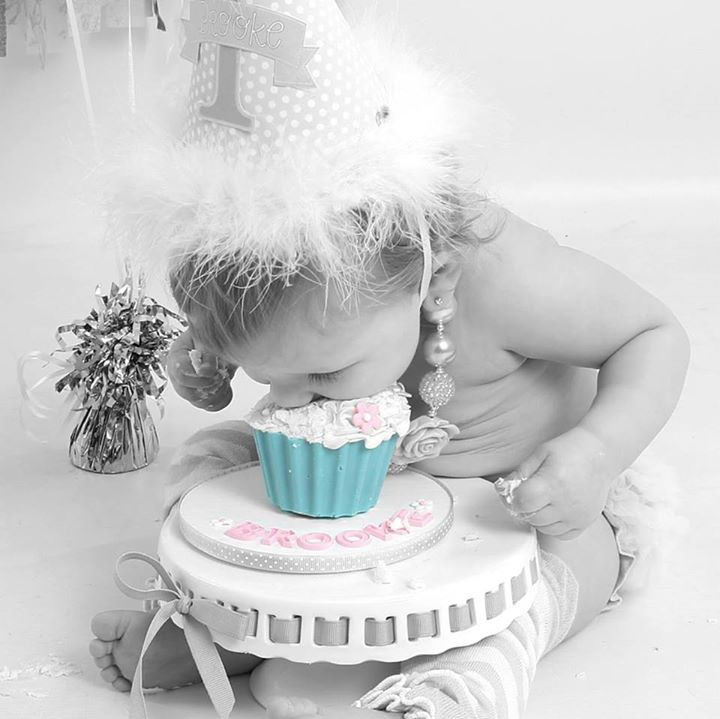 Brooke with her 1st Birthday Smash Cake