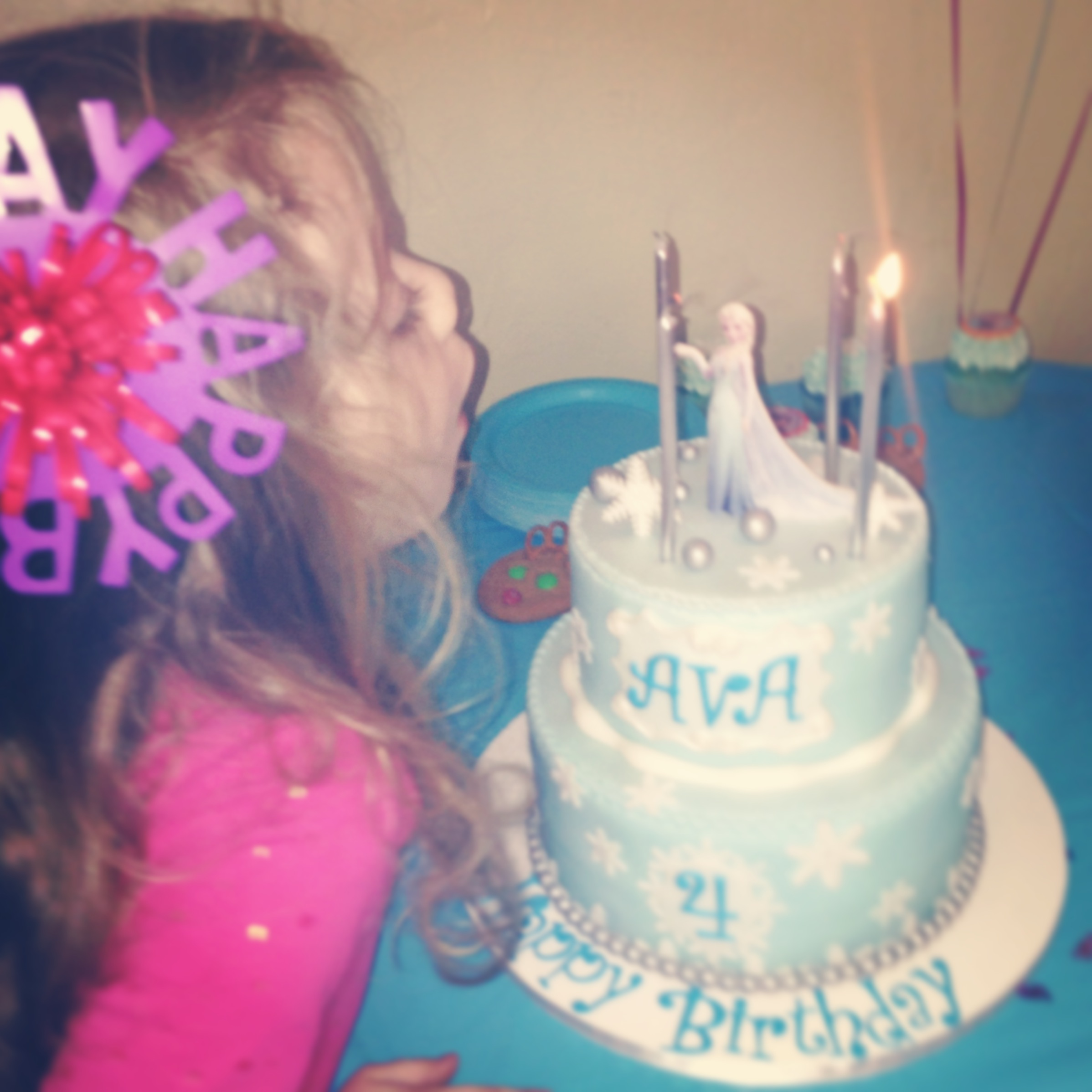 Ava and her Frozen cake