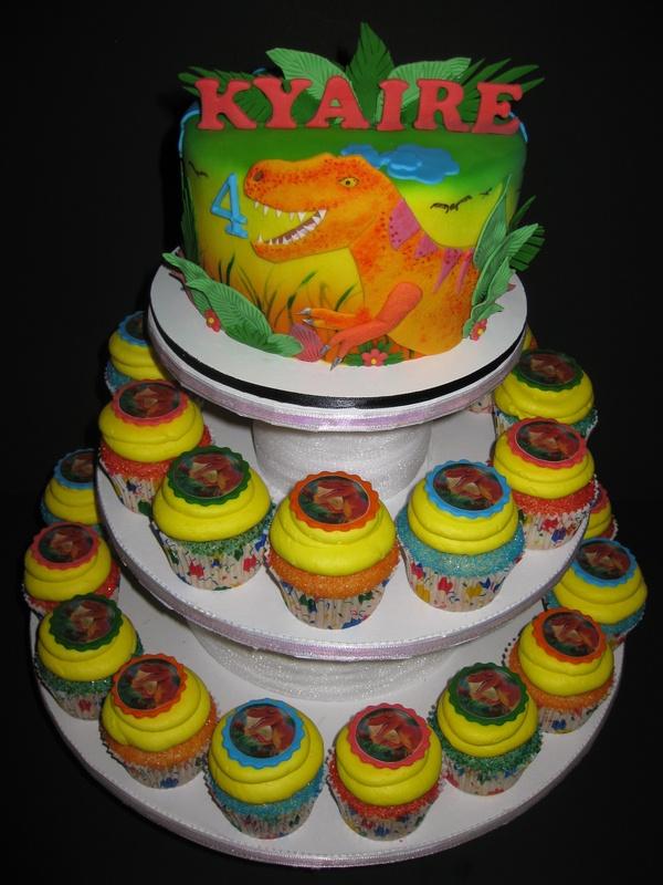 Display cake with 2 dozen of custom cupcakes with edible dinosaur